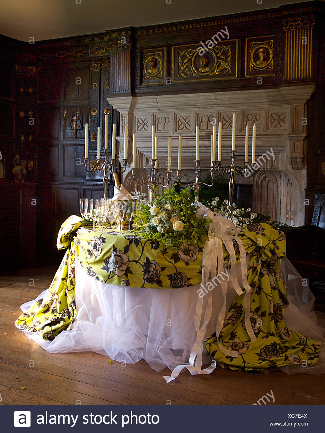 Opulent White Voile Cloth Draped With Green Floral Fabric On Table