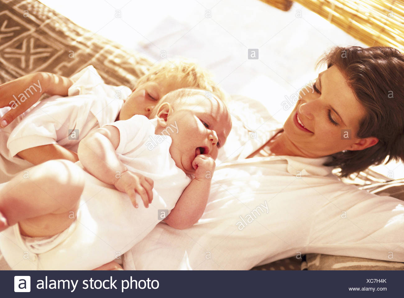 Woman 30 Years Maternity Care Love Security Closeness Cuddle Nestle Up Affection Tenderness Children Son Boy 4 Siblings 8 Months