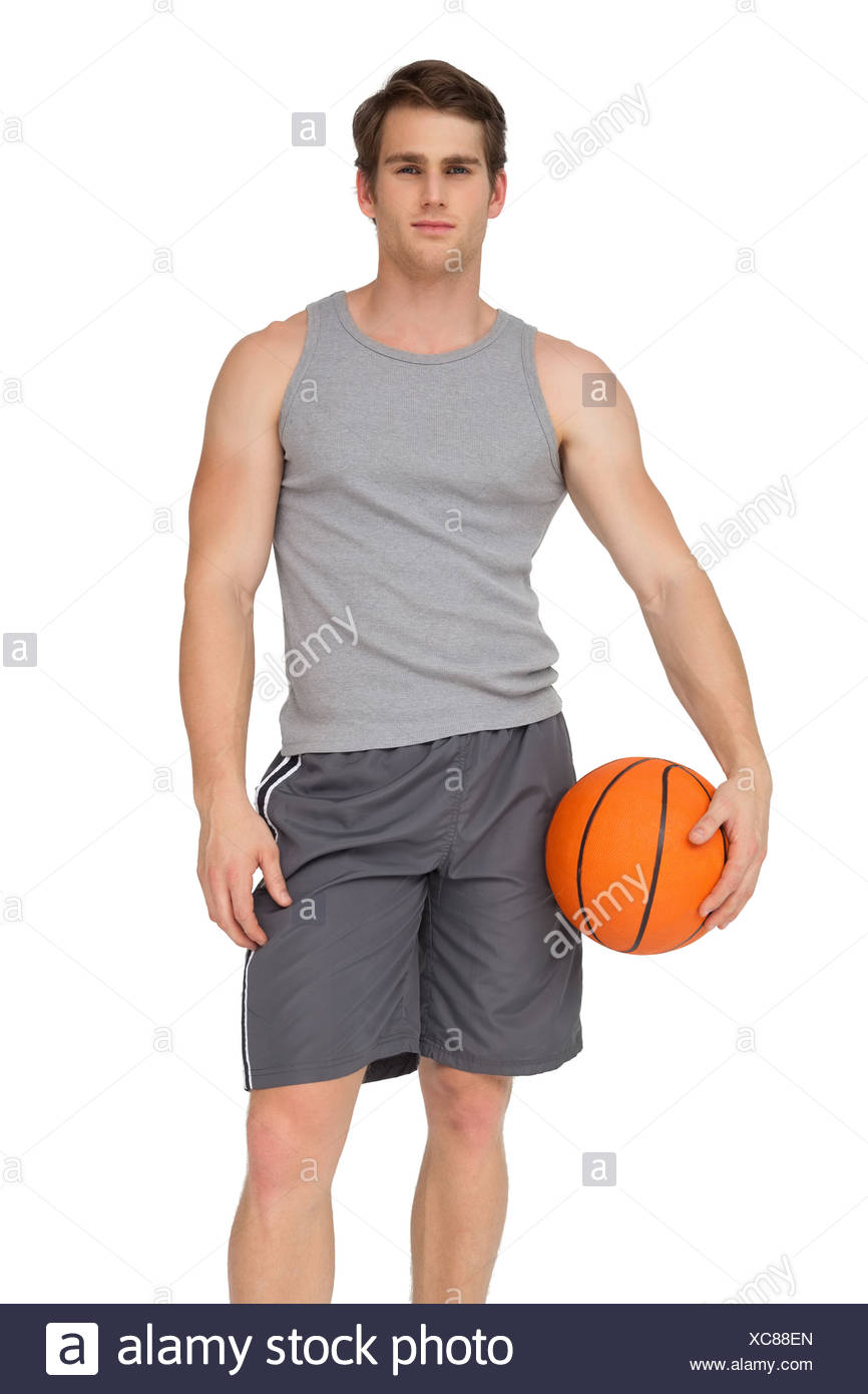 fit man holding basketball stock photo 282924061 alamy