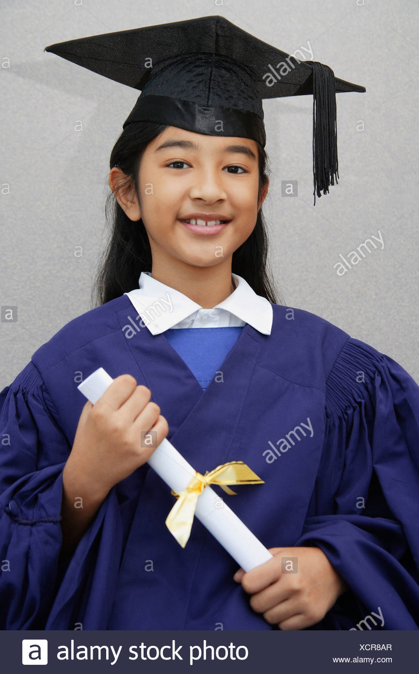 Indian girl holding a diploma wearing a graduation gown and cap ...
