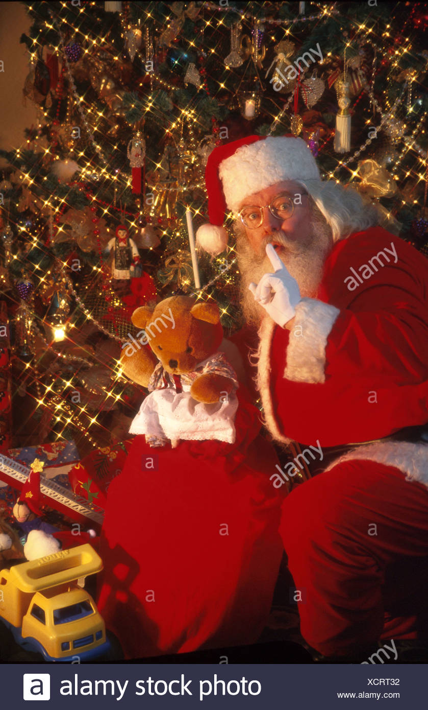 Santa Claus Puts Toys Under Christmas Tree Shhhh Stock Photo