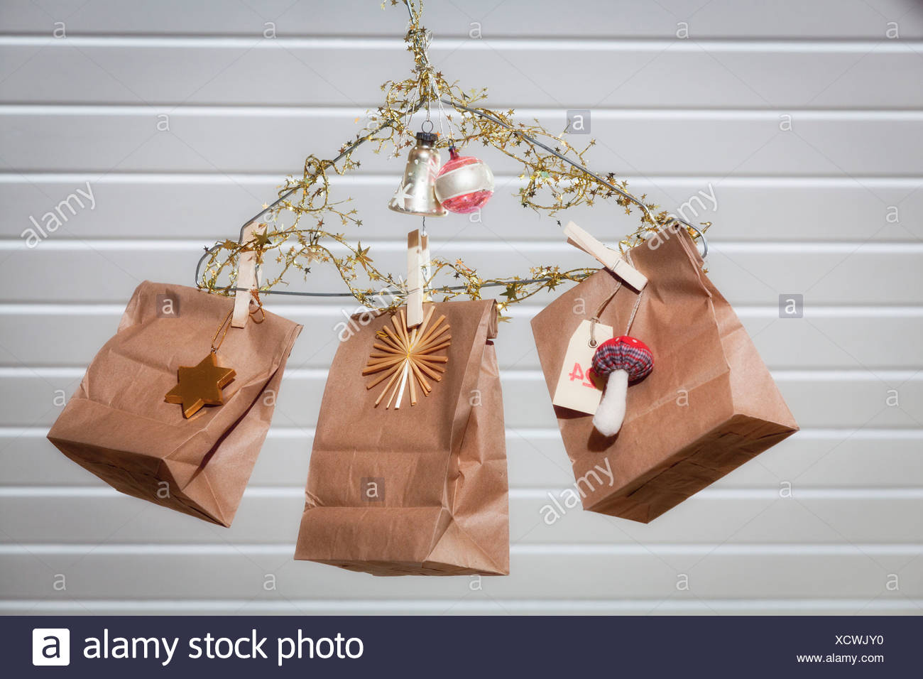 Christmas decoration gift bags hanging from coat hanger munich