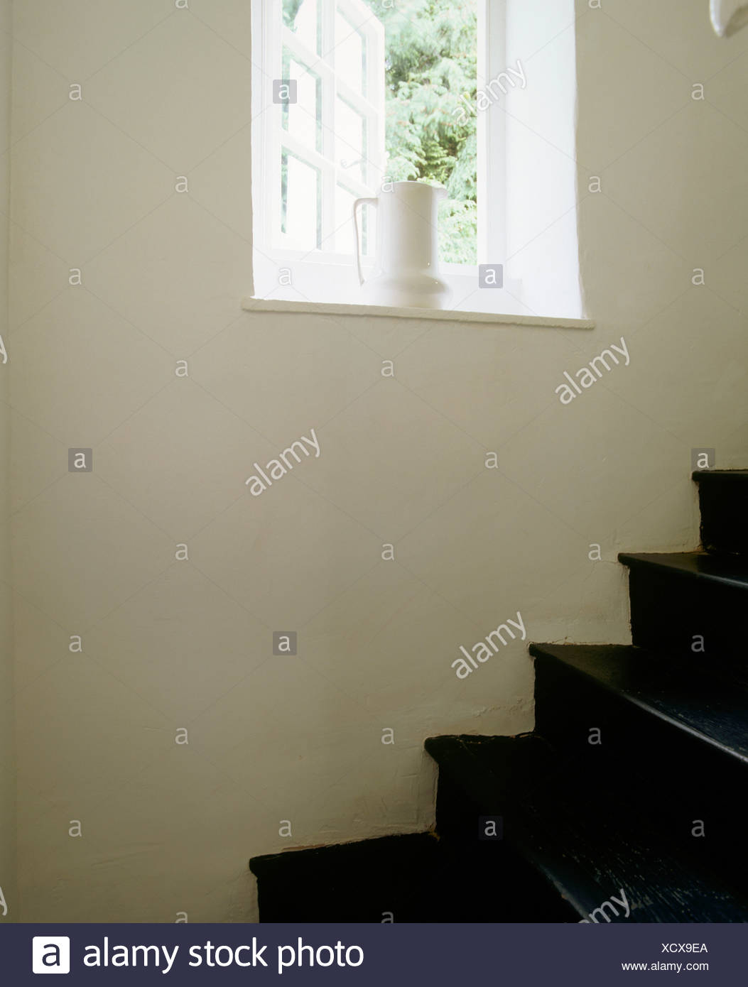 White Jug On Windowsill Of Open Window Above Black Painted Wooden Stairs In  Country Cottage
