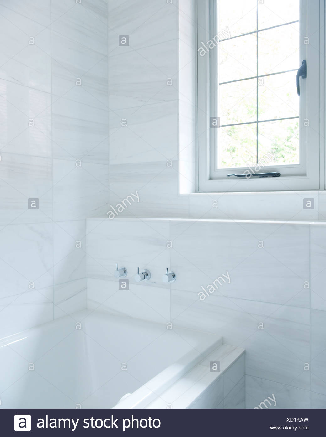 A bathroom with white marble tiles Stock Photo: 283393569 - Alamy