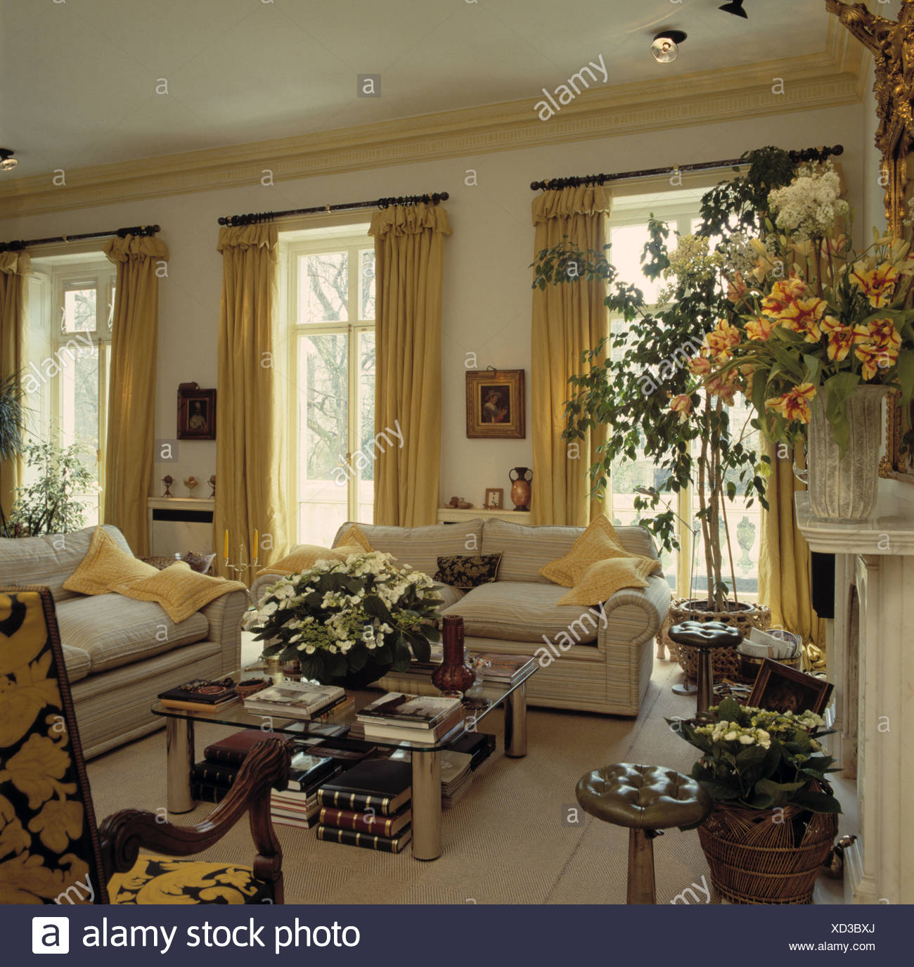 Attrayant Yellow Curtains French Windows In Traditional Living Room With Cream Sofas  And Floral Arrangements
