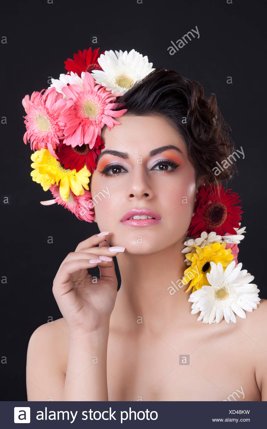 Portrait of a beautiful woman with flowers in hair stock photo portrait of a beautiful woman with flowers in hair izmirmasajfo