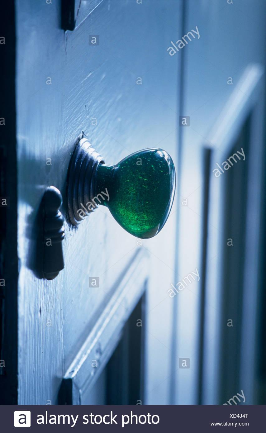 Close Up Of Green Glass Door Handle On Blue Door Stock Photo