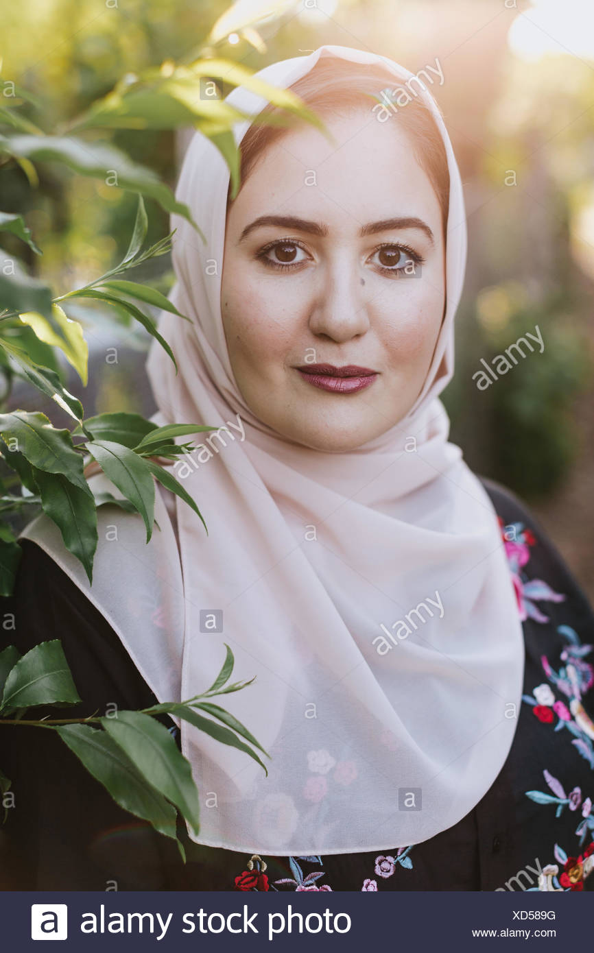 Portrait Of Young Woman Wearing Hijab Looking At Camera Stock Photo Headpiece