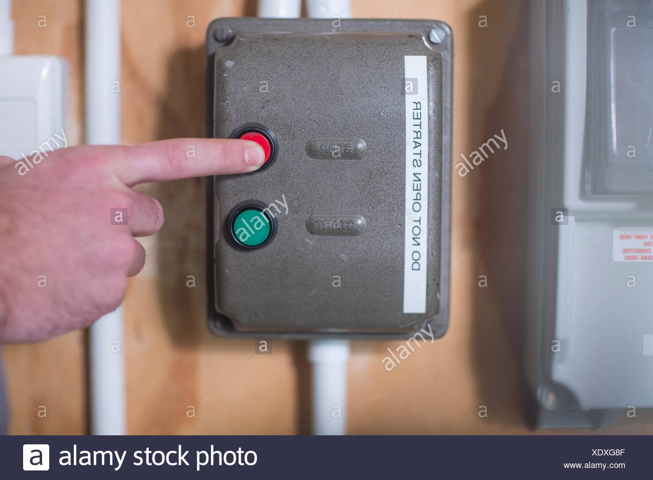 Hand turning off electrical control box Stock Photo: 283939951 - Alamy