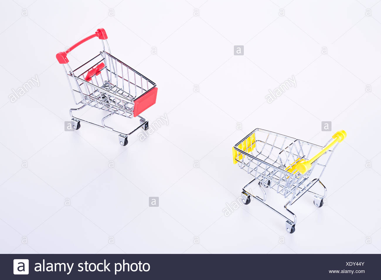 Two Rival Shopping Cart And Artworks On The White Background Stock Diagram