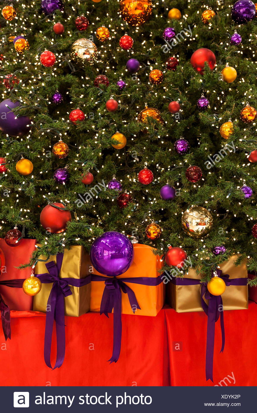 colourful christmas baubles fairy lights and gifts christmas tree