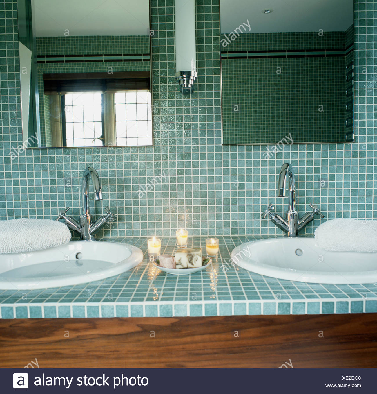 Close-up of mirrors and turquoise mosaic tiling above circular ...