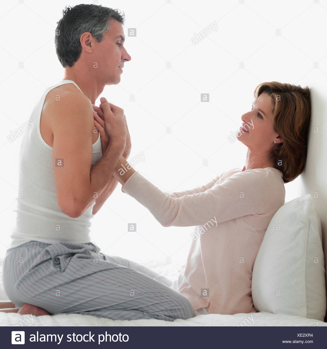 couple romancing in the bedroom stock photo 284036008 alamy