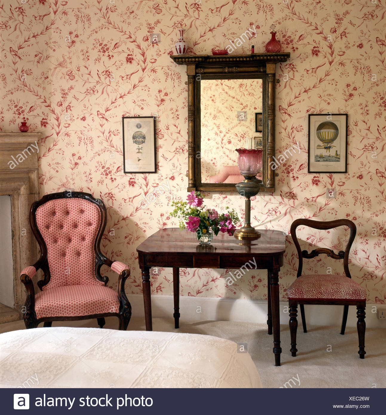 Pink Button Back Victorian Chair Beside Console Table In Bedroom With An  Antique Mirror And Pink Wallpaper
