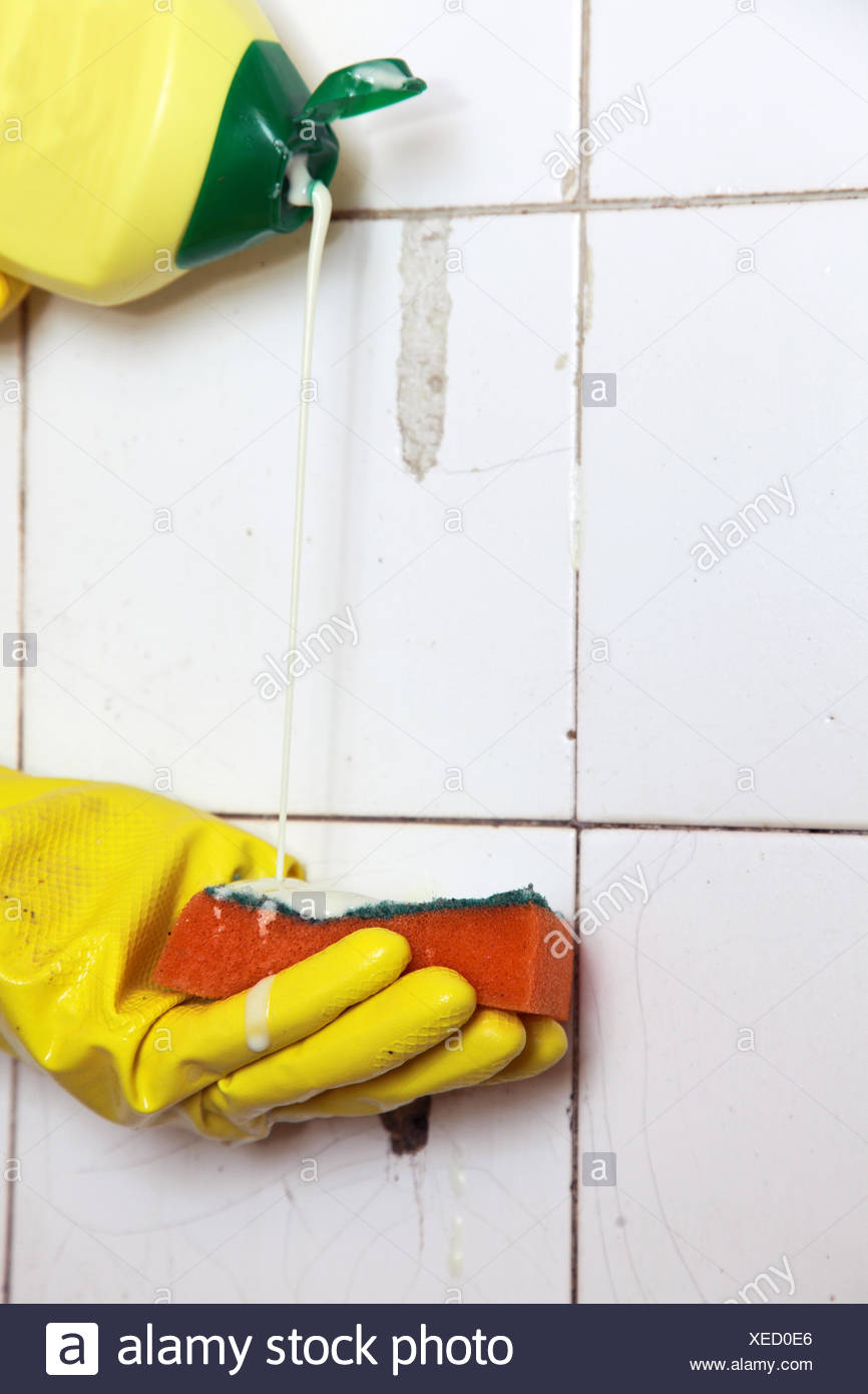 Cleaning of dirty old tiles in a bathroom Stock Photo: 284256846 - Alamy