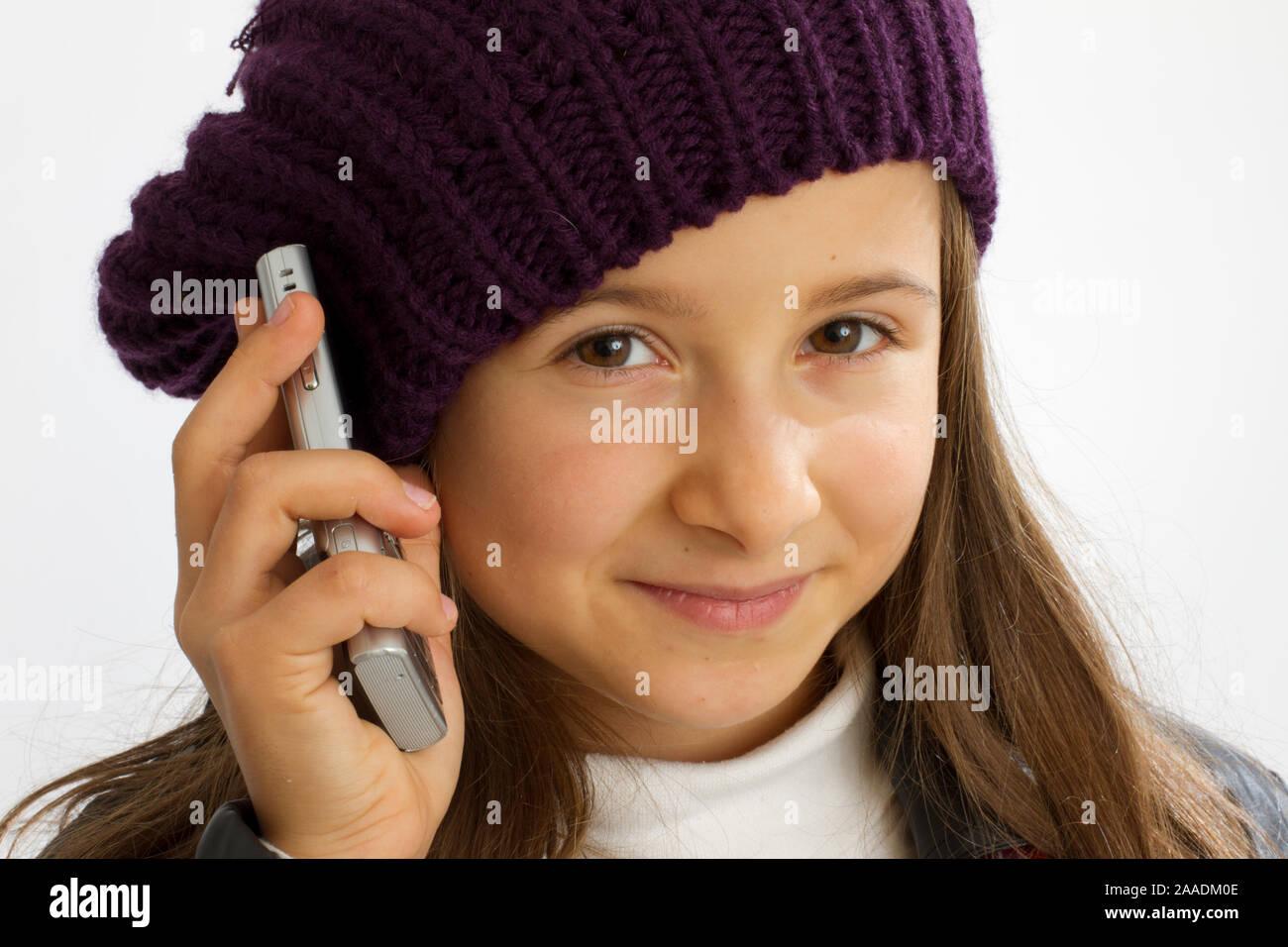 Mädchen mit Handy in der Hand Stockfoto