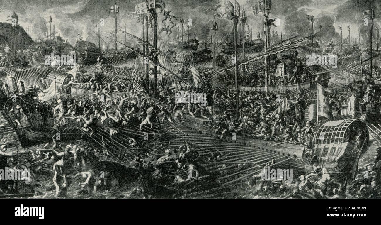 Gezeigt wird hier eine Szene der Seeschlacht bei Lepanto. Es stammt aus einem Fresko von Andrea Bicentino, das im Herzoglichen (oder Dogenpalast) in Venedig gemacht wurde. Die Schlacht von Lepanto war ein Marineengagement, das am 7. Oktober 1571 stattfand, als eine Flotte der Heiligen Liga, eine Koalition europäischer katholischer Staaten, die von Papst Paul V. organisiert wurde, der Flotte des Osmanenreiches im Golf von Patras eine große Niederlage zufügte. Andrea Vicentino (ca. 1542 - 1617) war ein italienischer Maler der späten Renaissance oder Manneristenzeit. Er war Schüler des Malers Giovanni Battista Maganza. Geboren in Vicenza, war er auch noch Kn Stockfoto