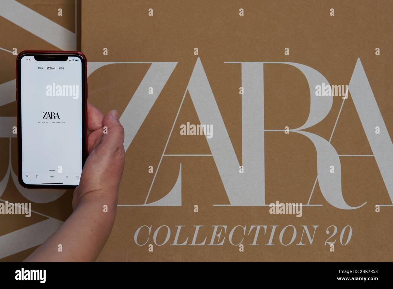 zara spanische kleidung marke online-lieferung box. hand auf