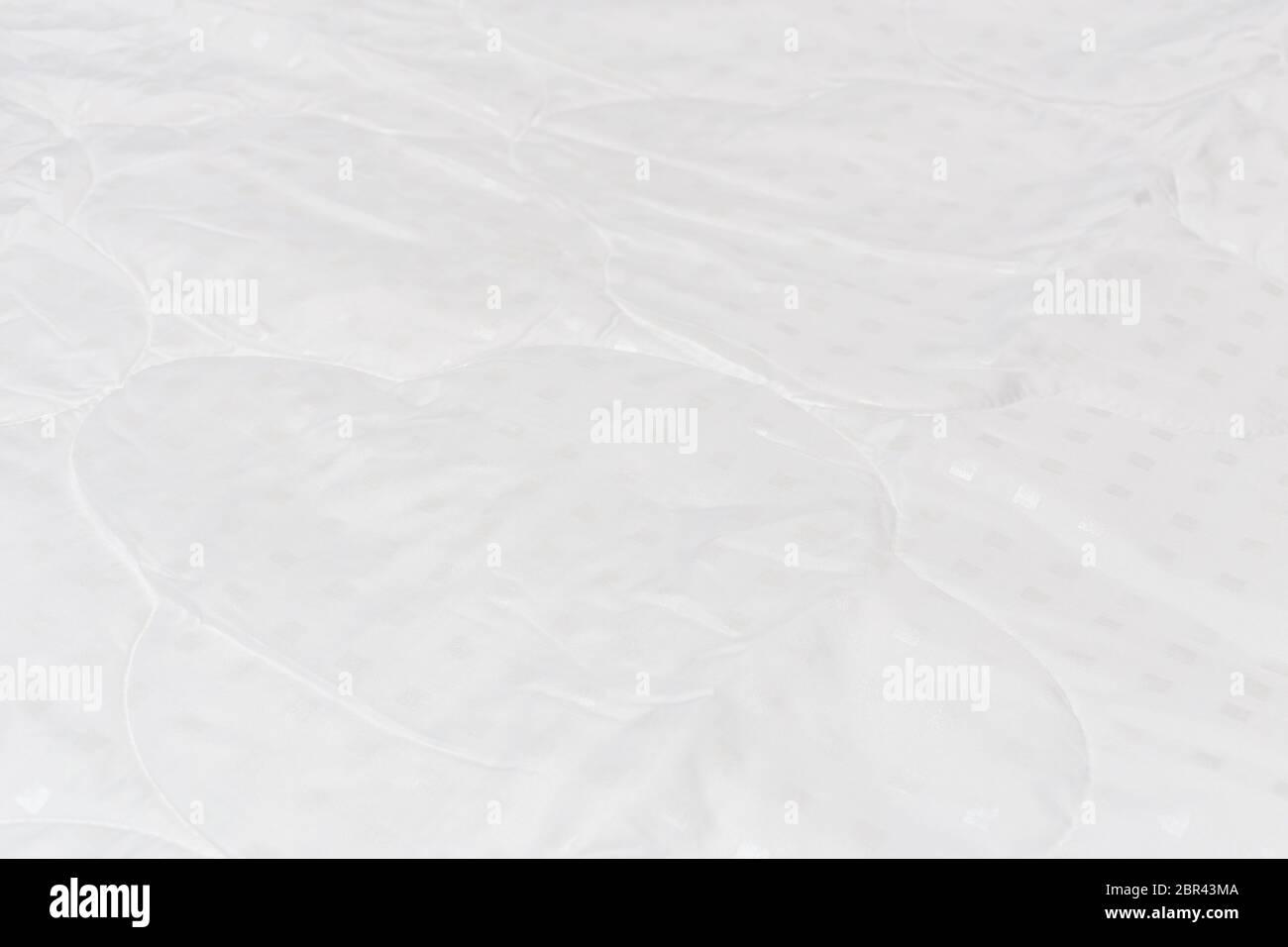 Weiße Stoffdecke Nahaufnahme Hintergrund mit selektivem Fokus und Hintergrund Weichzeichnen Stockfoto