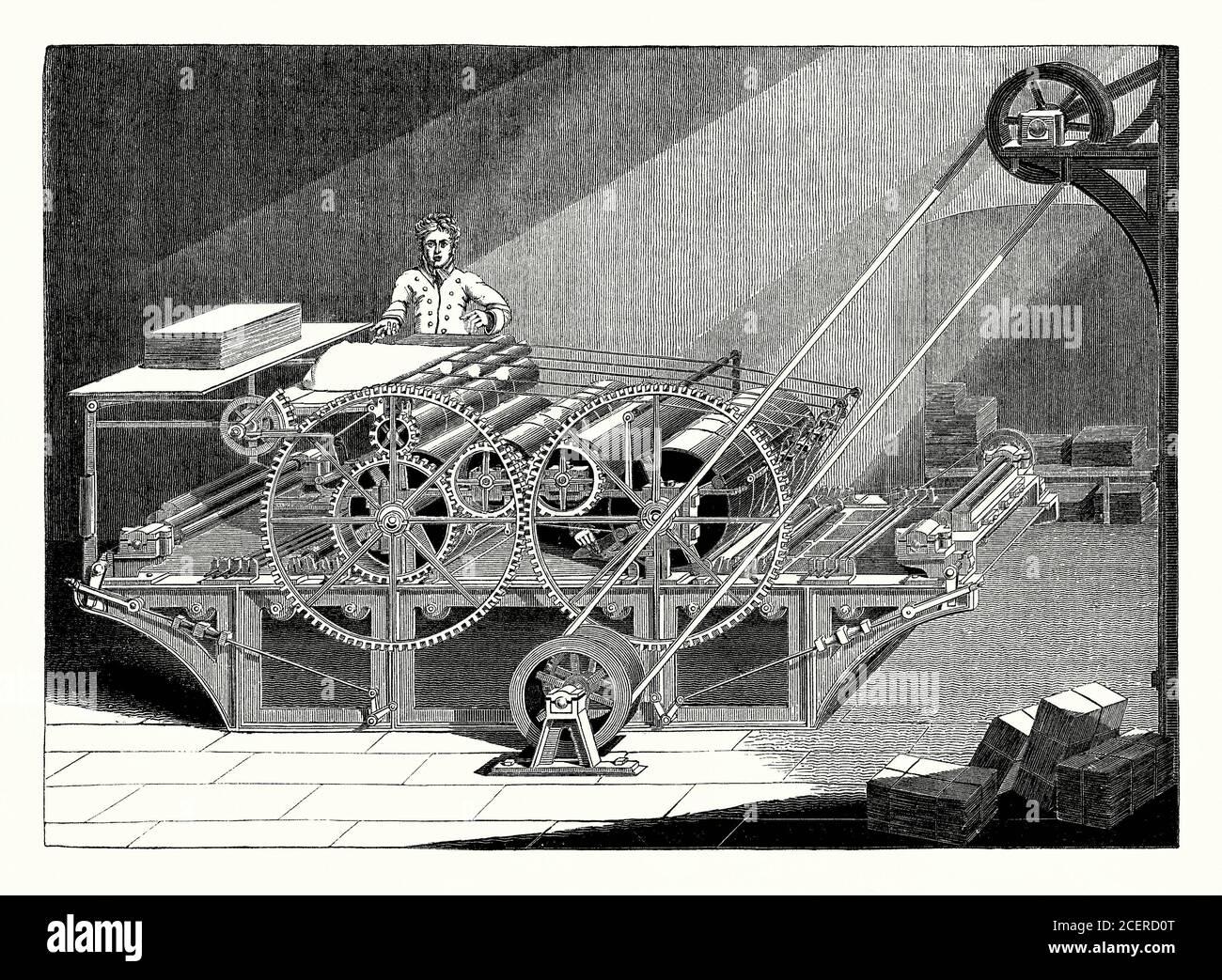 Eine alte 1800er Gravur einer dampfbetriebenen, rotierenden Zylinderdruckmaschine, die in der industriellen Revolution der viktorianischen Zeit verwendet wurde. Die Deutschen Friedrich Koenig und Andreas Bauer entwarfen und bauten Anfang des 19. Jahrhunderts ihre erste Zylinderpresse. Sie war viel schneller als die bestehenden Flachbettpressen. Einer ihrer ersten Kunden war John Walter von der Zeitung The Times. Die erste Ausgabe der Times, die die neuen Druckmaschinen verwendete, wurde 1814 veröffentlicht. Die Presse wurde heimlich installiert, um Sabotage durch verärgerte Pressearbeiter (Ludditen) zu vermeiden, die die bestehenden Pressen betrieben. Stockfoto
