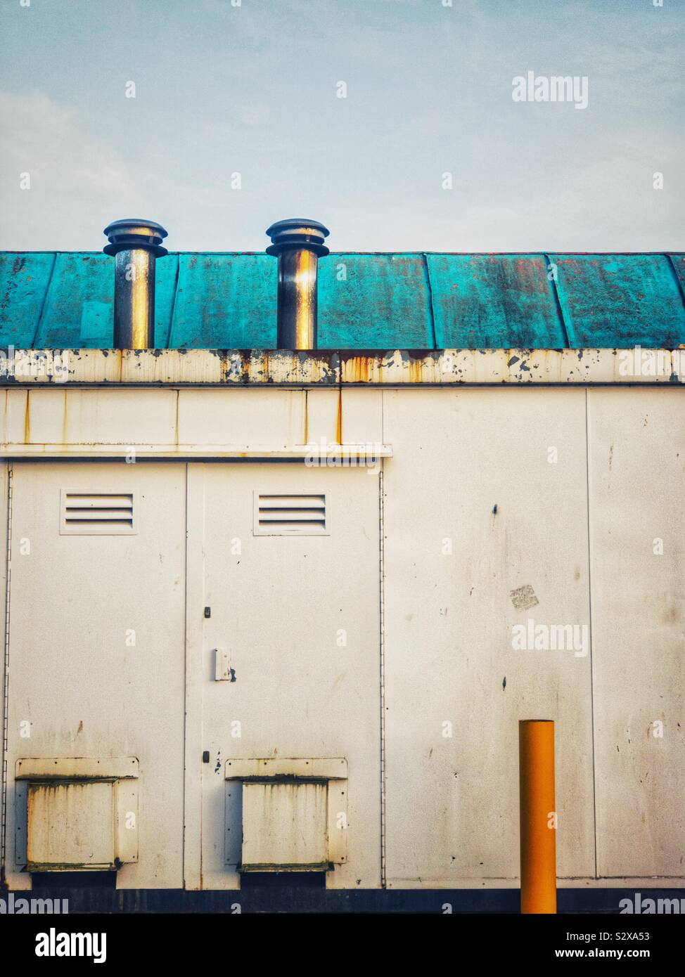 Industrial equipment on side of building. Stock Foto