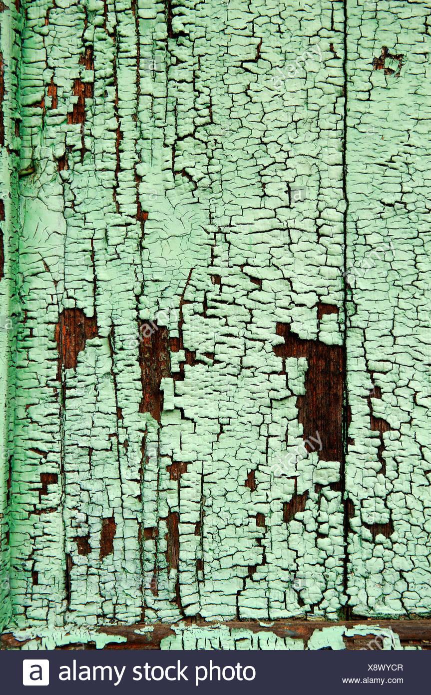 leichte grüne lack, farbe abplatzt oberfläche des holzes stockfoto