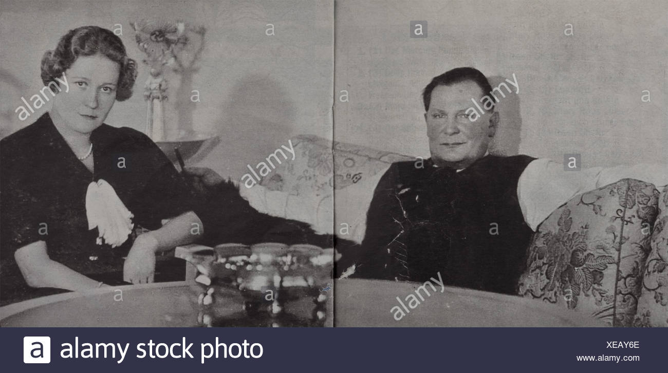 Hermann Göring - an important, splendid table centrepiece from Carinhall, Professor Herbert Zeitner, Berlin. Multiple sections fashioned in silver, gilt in places. A large hand-fashioned silver bowl with cylindrical foot and very wide oak leaf engraving, typical for Zeitner. In the centre a high, conical silver column with a frieze of gilt oak leaves, crowned by a modelled St. Hubertus-Stag's head surmounted by a gilt radiate star and a central swastika. Interior retaining bar is present, lock nut missing. The bowl and foot with a few repairs. Multiple jeweller, Additional-Rights-Clearences-NA Stockbild