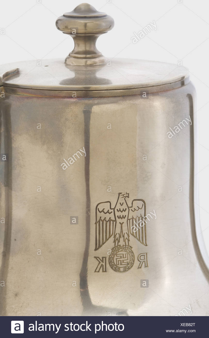 Adolf Hitler, a coffee service from the table silver of the Neue Reichskanzlei, Berlin. A four-piece set, consisting of a coffee pot, creamer, and sugar bowl. Each in the hard silver-plated version. The coffee pot is engraved with the party eagle above 'RK' and on the bottom bears the maker's mark 'Wellner', '170 cl.', '39' in a circle. Height 22.5 cm, width 27.5 cm. The creamer has 'Wellner', '100 cl.', '22' in a circle. 17.5 x 18.5 cm. The sugar bowl has 'Wellner', '75 cl.', '22' in a circle. 13 x 22 cm. The tray is without party eagle and is stamped 'Wellner, Additional-Rights-Clearences-NA Stockbild