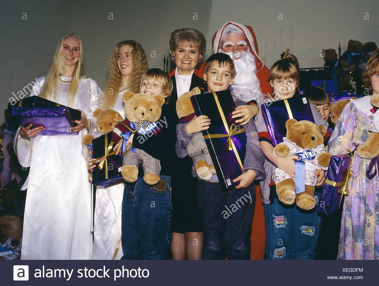 Kohl, Helmut, * 3.4.1930, German politician (CDU), his wife Hannelore, half length, on advent celebration in children hospital W Stockbild