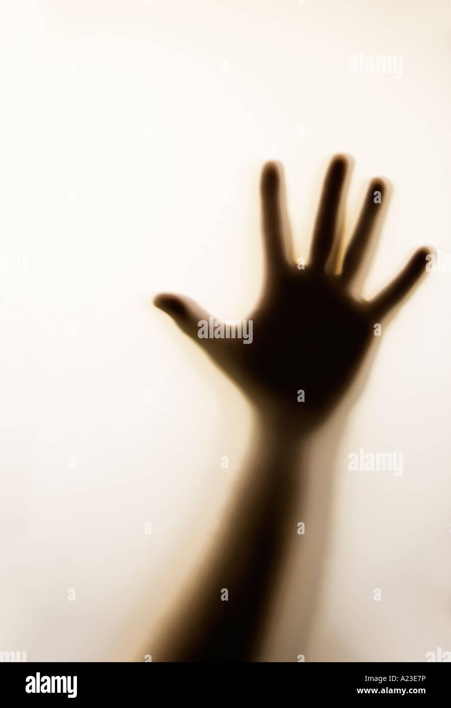 Silhouette von Hand gegen Milchglas erwachsenen Mann männlich Stockbild