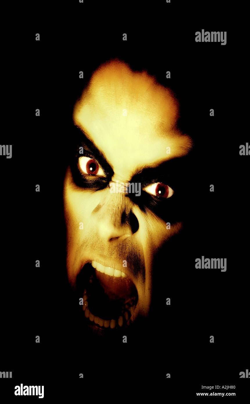 dämonische Gesicht eines Mannes. Stockbild