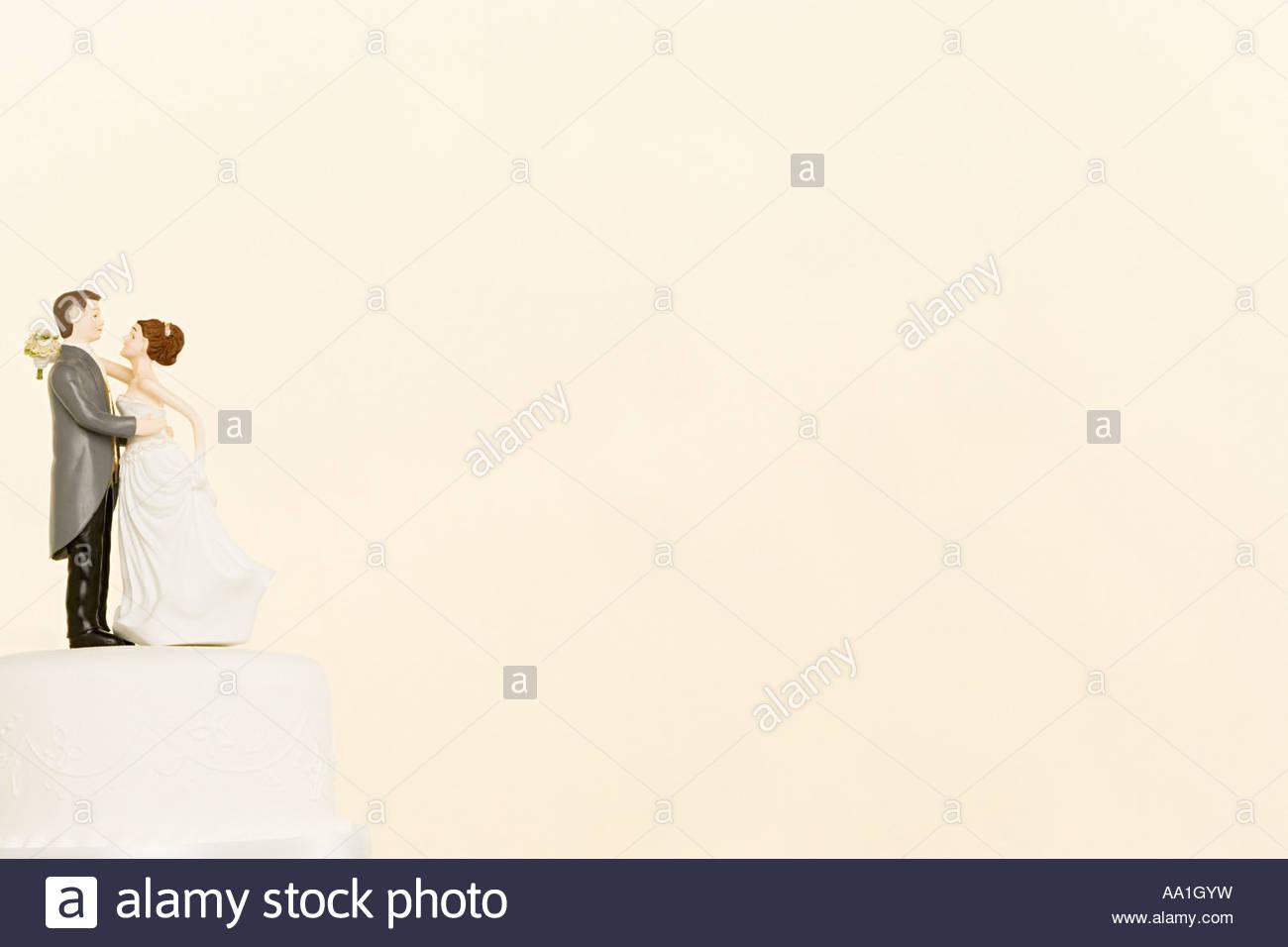 Hochzeit Figuren auf Kuchen Stockbild
