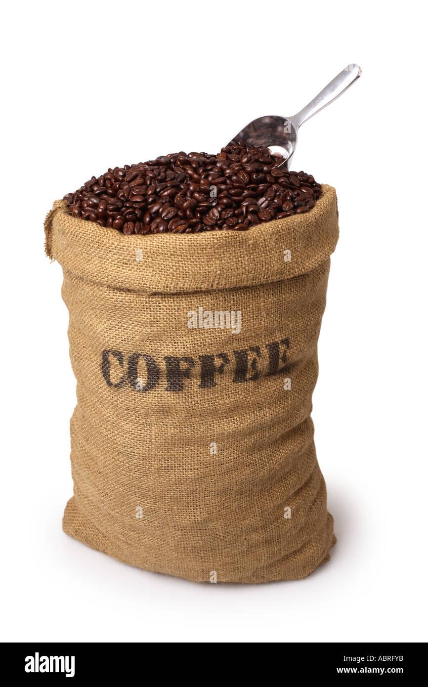 Leinensack Kaffeebohnen mit Schaufel Stockbild