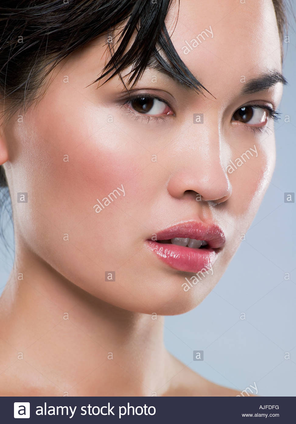 Nahaufnahme von einer jungen chinesischen Womans Gesicht Stockbild