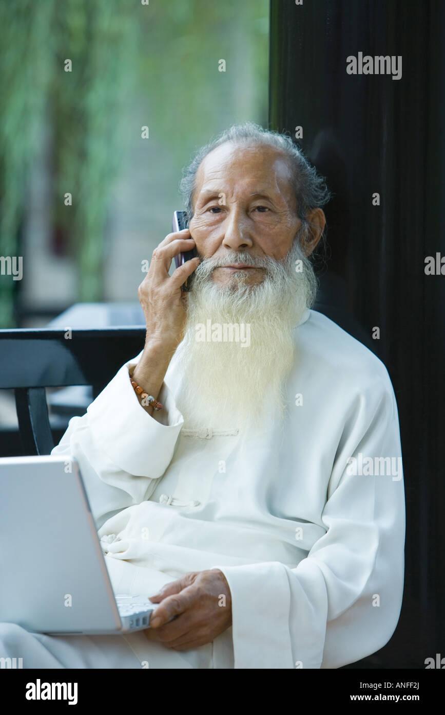portrait old chinese man sitting stockfotos portrait old. Black Bedroom Furniture Sets. Home Design Ideas
