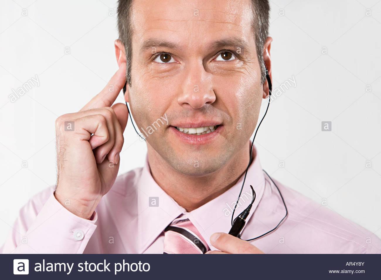 Geschäftsmann, tragen ein Hände frei Gerät Stockbild