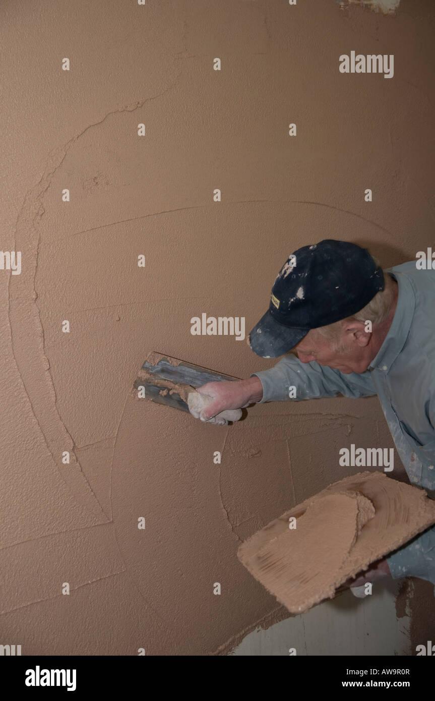 Glatten Der Putz An Wand Distel Anleihe Stockfoto Bild 16512502