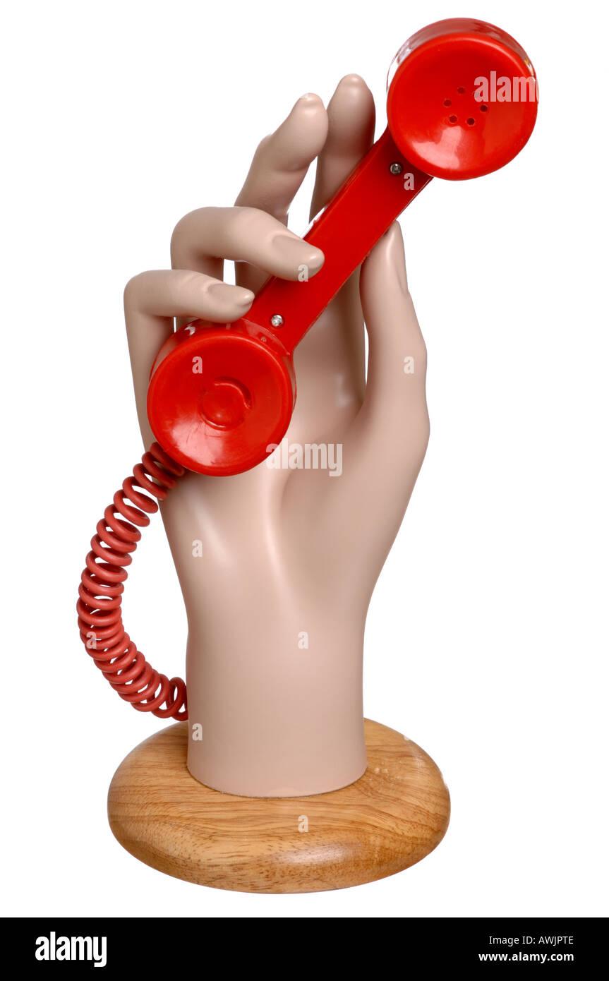 Schaufensterpuppe Hand hält einen roten Telefonhörer Stockbild