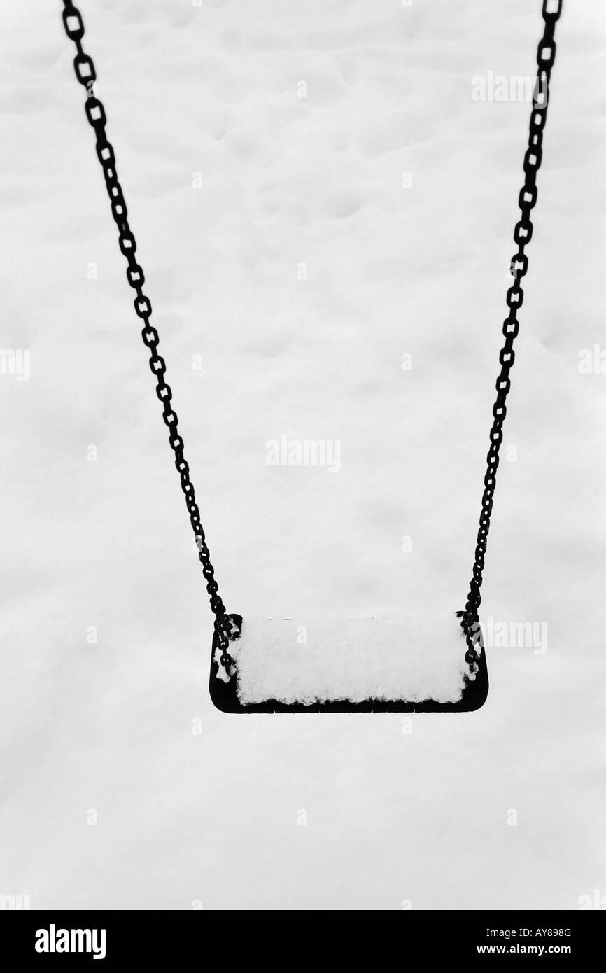 Swing im Schnee Stockbild