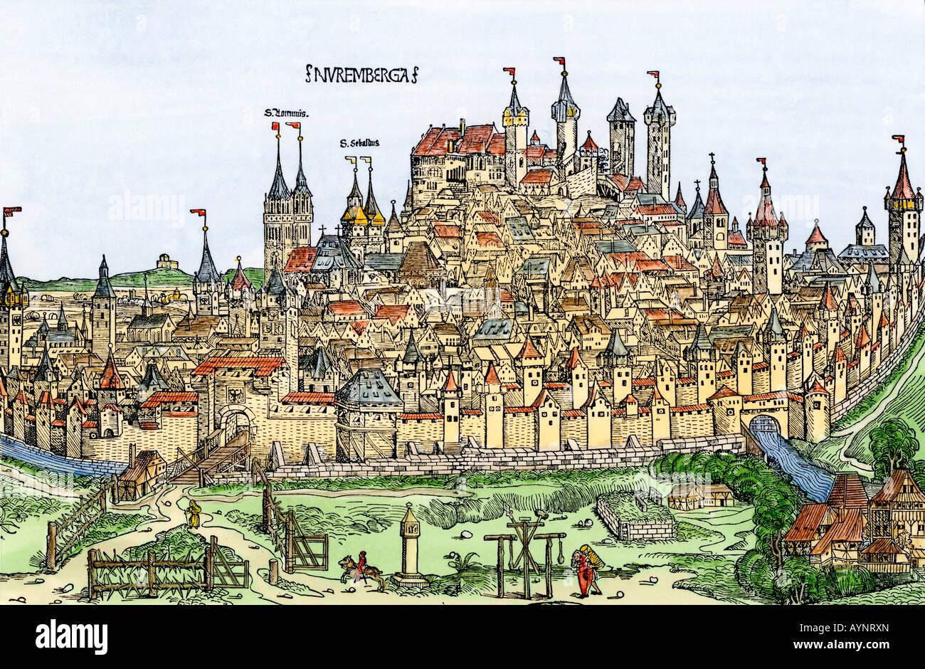 Von einer mittelalterlichen Stadtmauer umgebenen Stadt Nürnberg Deutschland 1400. Hand - farbige Holzschnitt Stockbild
