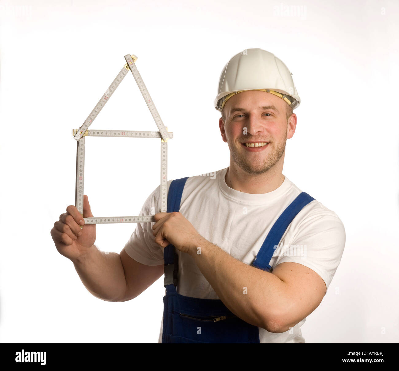 Bauarbeiter mit Zollstock (Maßstab) Stockbild