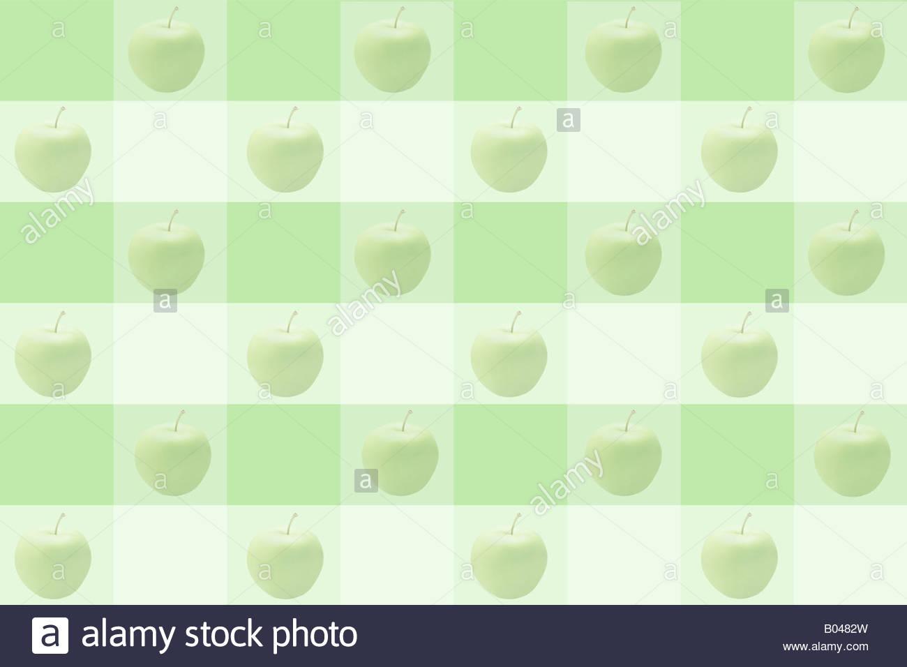 Äpfel auf einem Schachbrettmuster Stockbild