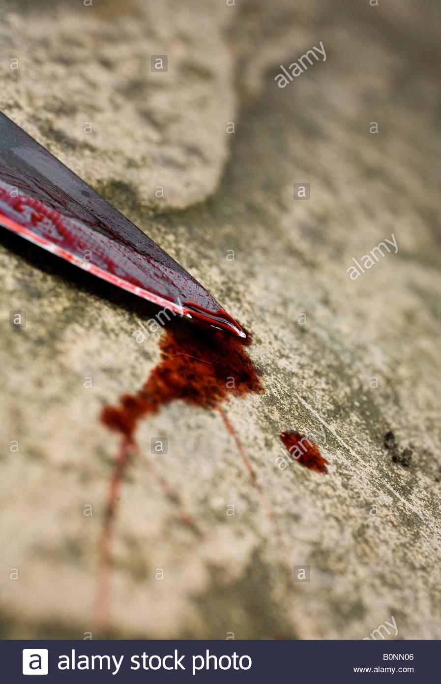 Blutiges Messer Stockbild