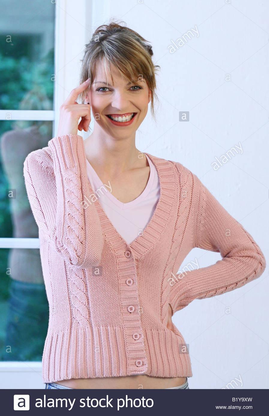 Frau mit Zeigefinger gestikulieren Stockbild