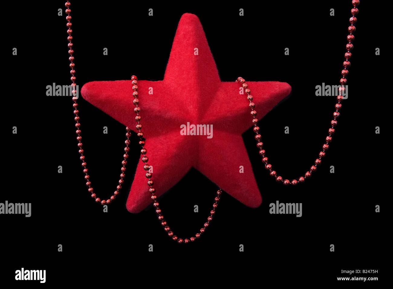 Ein Stern und Perlen Weihnachtsschmuck Stockbild