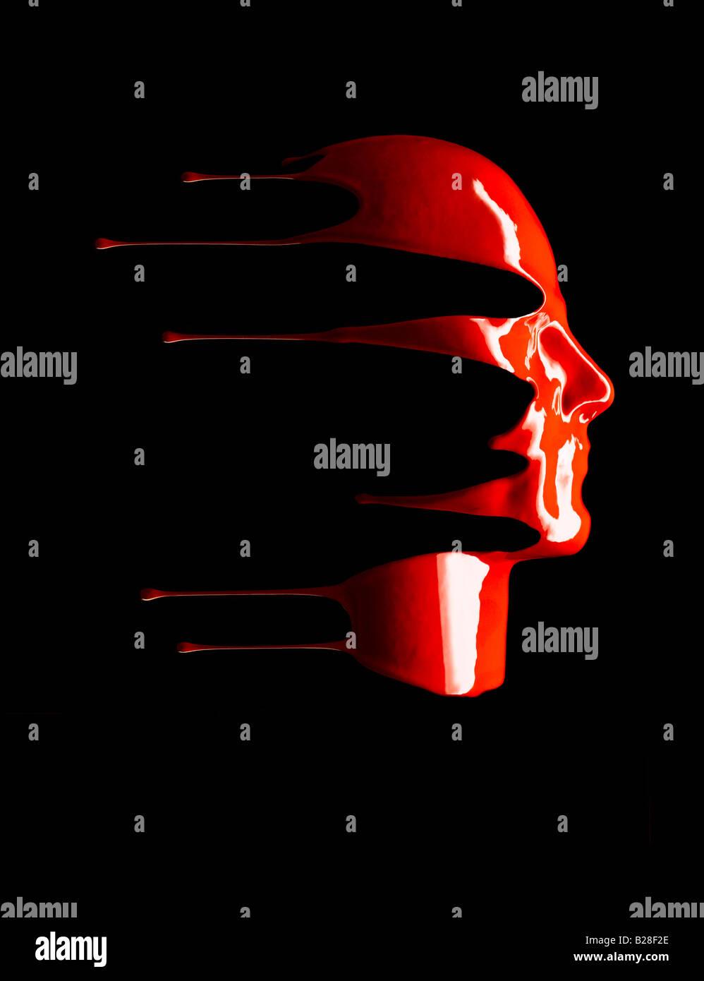 Rote Flüssigkeit tropft unten ein Gesicht. Stockfoto