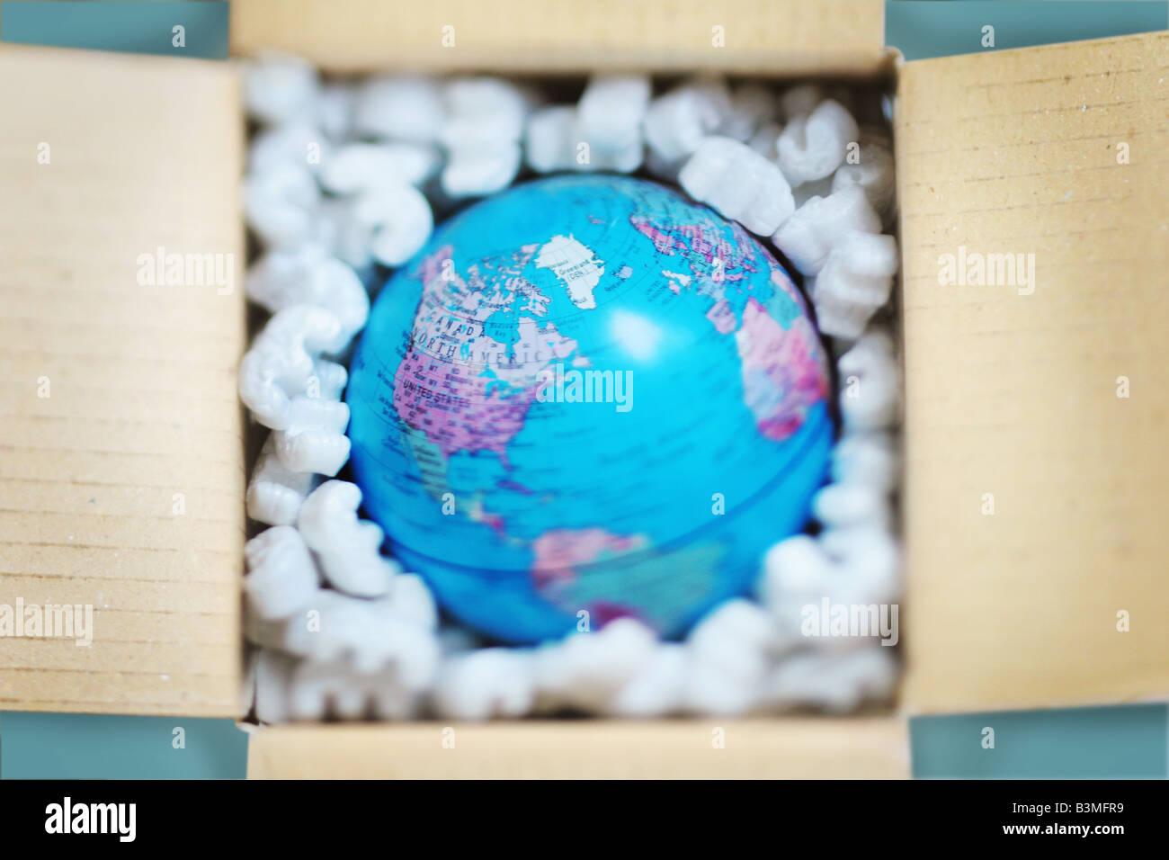 Globus in einer Schutzverpackung Stockbild