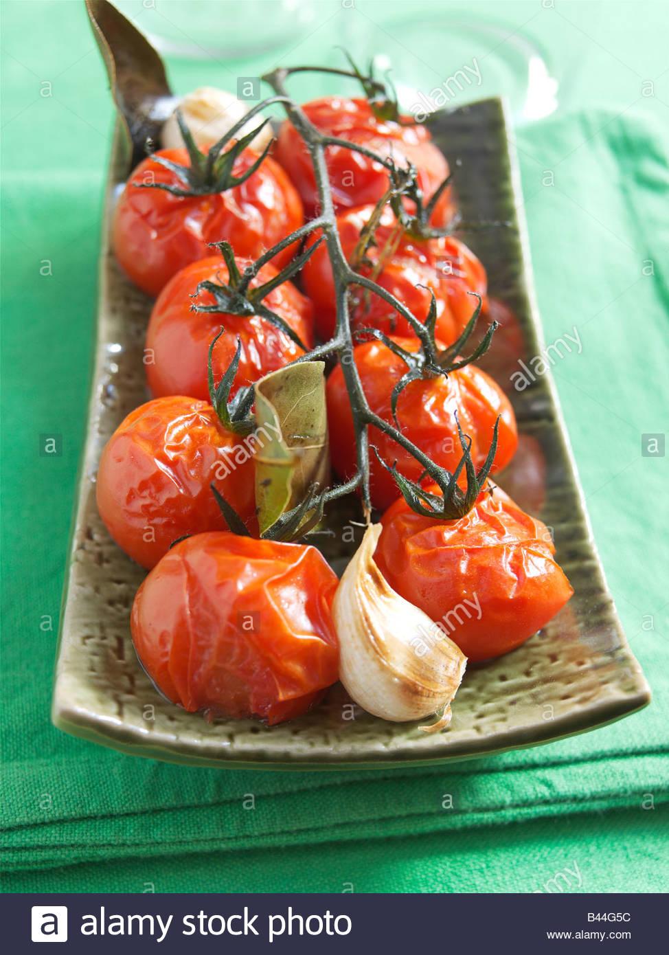 Gekochte Bündel von Tomaten Stockfoto