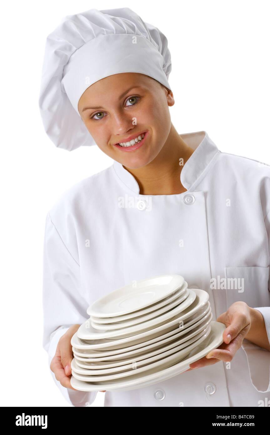 Junge Köchin hält einen Stapel von Platten. Stockbild