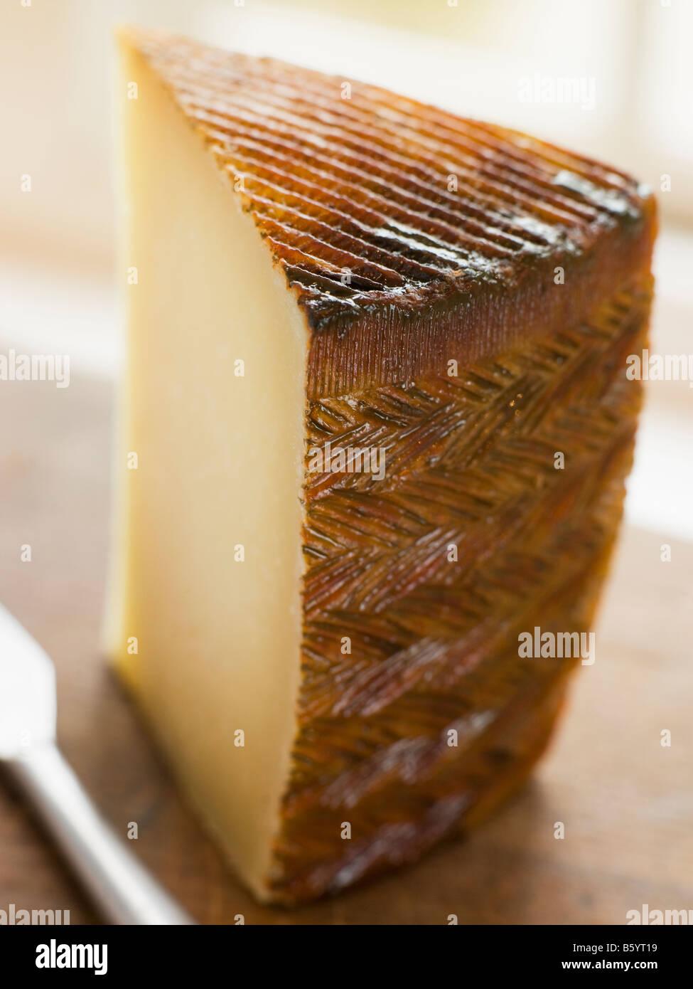 Keil von Manchego-Käse Stockbild